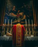 Low Mass in red vestments at the altar of the Nativity royalty free stock image