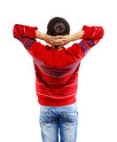 View from behind. Man in red pullover standing back isolated on white background Stock Image