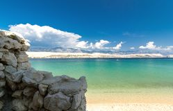 View from behind the stone wall on the beautiful blue Adriatic sea royalty free stock images