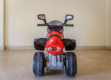 View from behind of a toy motorcycle, in the living room of a ho Stock Photos