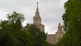 View from behind the trees on the building of Moscow State University stock video