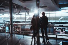 View from behind of two women in airport terminal stock photos