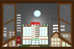 View from behind the window, the city`s night time atmosphere. - Royalty Free Stock Images