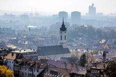 View of the Belgrade in the haze, Serbia. View of the Mother of God Nativity Church in Zemun and Belgrade in the haze, Serbia Royalty Free Stock Photos