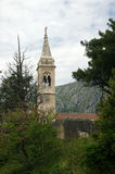 View of the bell tower. Of the church of Saint Eustache (Dobrota, Montenegro Stock Image