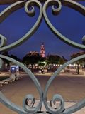 A view of bell tower through a fence at night Stock Photography