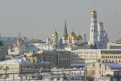 View of the bell tower of Ivan the Great. View of the Kremlin, Ivan the Great bell tower and the Cathedral of the Assumption in winter Stock Image