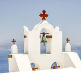 View of bell tower in oia santorini and part of caldera Stock Photos