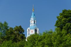 View of the bell tower of the Orthodox Cathedral framed by greenery. Spaso-Preobrazhensky Cathedral of the Valaam Monastery stock images