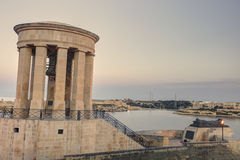 View of the bell tower of Siege Bell Memorial in Valletta, Malta, on cloudy sky background Royalty Free Stock Image