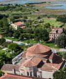 View from the bell tower of Torcello. View of Torcello from the bell tower in the foreground with the complex of the church of Santa Fosca Royalty Free Stock Image