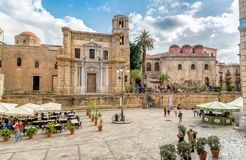 View of Bellini Square with tourists visiting the Santa Maria dell`Ammiraglio Church and San Cataldo Church. Palermo, Sicily, Italy - October 5, 2017: View of Stock Photography