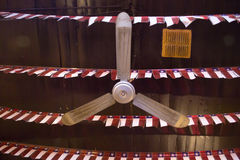 A view from bellow of a roof fan in a restaurant. A view from bellow of a roof fan in a old vintage restaurant Stock Images