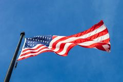 View from bellow of waving flag of the United States with blue s stock image