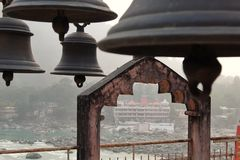 View of bells in hinduist temple Shri Makar Vahani Ganga Jee and Sita Ram Dham Ashram on the riverbank of Ganga in Rishikesh Stock Photography