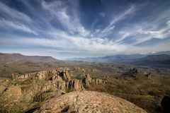 View of the Belogradchik Rocks. The Belogradchik Rocks are a group of strange shaped sandstone and conglomerate rock formations located on the western slopes of Royalty Free Stock Images