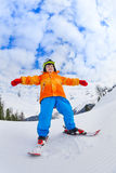View from below of boy in ski mask skiing Stock Image