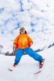 View from below of boy wearing ski mask and skiing Royalty Free Stock Images