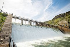 Unique perspective on a diversion dam on an Idaho river. View from below a dam in the spring time royalty free stock images