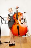 View from below of girl playing violoncello Stock Photos