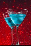 View from below of glasses of fresh blue cocktail with ice Royalty Free Stock Images