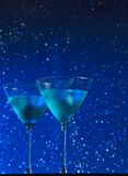 View from below of glasses of fresh blue cocktail with ice Royalty Free Stock Photos