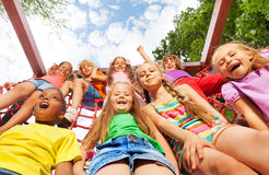 View from below of happy kids on net ropes Royalty Free Stock Image