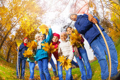 View from below of kids diversity in autumn park Stock Images