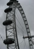 The London Eye. A view from below on the London Eye. Shoot taken on a cloudy day Stock Photo