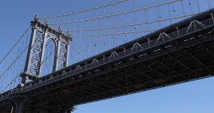 View from below of the Manhattan Bridge. View from below of the Manhattan Bridge and Brooklyn Dumbo Beach Royalty Free Stock Photos