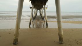 View from below a pier in Torquay, Queensland, Australia stock footage