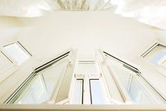 View from below of plastic vinyl window with white transparent c. View from below of plastic vinyl window with tulle transparent curtain stock images