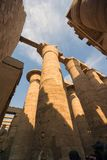 View from below the ruins of the huge columns of the Luxor temple in the hypostyle hall full of hieroglyphic images, in Egypt stock photo