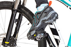 View from below of special contact shoe attached to the bicycle Stock Photos