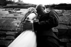 A view from below on a stunning bride hidden in groom's hugs Royalty Free Stock Images