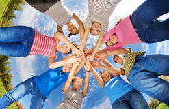 View from below of teens standing in star shape Royalty Free Stock Image