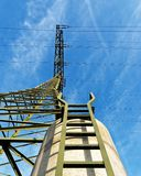 Electricity pylon from below perspective stock photography