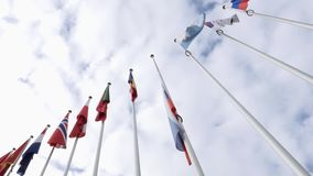 View from below of waving Russian Federation flag half-mast. STRASBOURG, FRANCE - MAR 28, 2018: Low angle of flag of Russia flying half-mast at Council of Europe stock footage