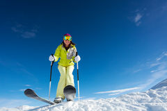 View from below of woman in mask holding poles. View from below of happy woman in mask  holding ski poles and ready to ski at Krasnaya polyana ski resort and Royalty Free Stock Photos