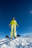 View from below of young woman in mask  with poles. View from below of young woman in mask  holding ski poles and ready to ski at Krasnaya polyana ski resort and Stock Images