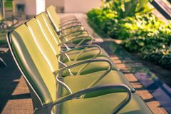 A view of a bench in a airport with a sunrise light royalty free stock images