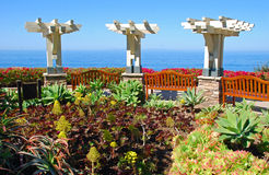 View benches overlooking coastline below Montage Resort. Image shows one of many viewing benches, in a park, for viewing coastline and beaches below the Montage Stock Photography