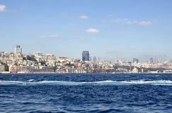View of Besiktas, Kabatas and Beyoglu areas. Of Istanbul from Sirkeci ferry station. Irregular urbanization is in the view royalty free stock photography