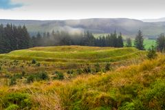 Hill Fort Eskdalemuir. A view of Bessies Hill Hill Fort near Eskdalemuir in Dumfries and Galloway, south west Scotland. The fort is close to a settlement and royalty free stock images