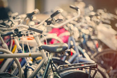 View on bicycles on parking places close up. Beautiful view on bicycles on parking places close up Stock Photos