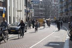 View of bicyclist on Amsterdam street, Netherland Stock Photos