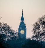 View of Big Ben in a haze from Buckingham Palace early in the morning, London Stock Photo