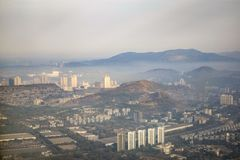 View of the big city in the mountains with different buildings.  royalty free stock photography