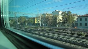 View of a Big City out from a Window of a Train. From a Passenger Train to Florence stock video