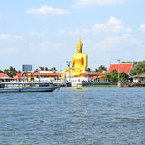 The view of big golden buddha be side the Chao Phraya river Royalty Free Stock Photography